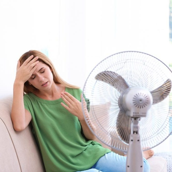 Woman suffering from heat at home